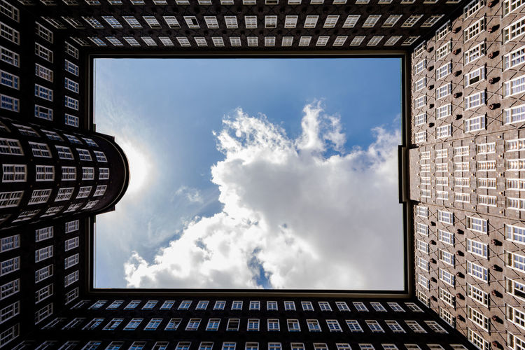 the framed cloud Architecture Cloud - Sky Sky Built Structure Building Exterior Nature Building Brick No People Low Angle View Wall Brick Wall Outdoors Sunlight Achievement Windows Exceptional Photographs EyeEm Best Shots Hamburg Symmetry Architectural Column Springtime Decadence The Architect - 2019 EyeEm Awards