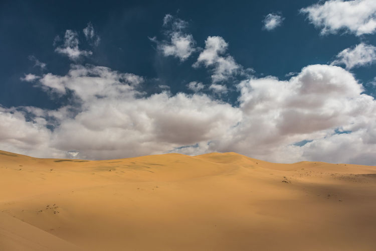Mongolia Cloud - Sky Sky Scenics - Nature Desert Tranquil Scene Beauty In Nature Tranquility Land Landscape Sand Sand Dune Climate Non-urban Scene Arid Climate Environment Nature Remote Day No People Idyllic Outdoors Atmospheric