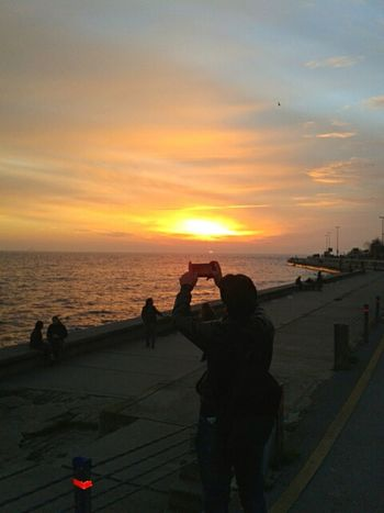 The Following Sunset Sunshine Photographer Photographylovers Reflection Camera Life With You Sunrise Sunset_collection Sunsetlover Mobilephotography People And Nature Peoplephotography Seaside Sea And Sky
