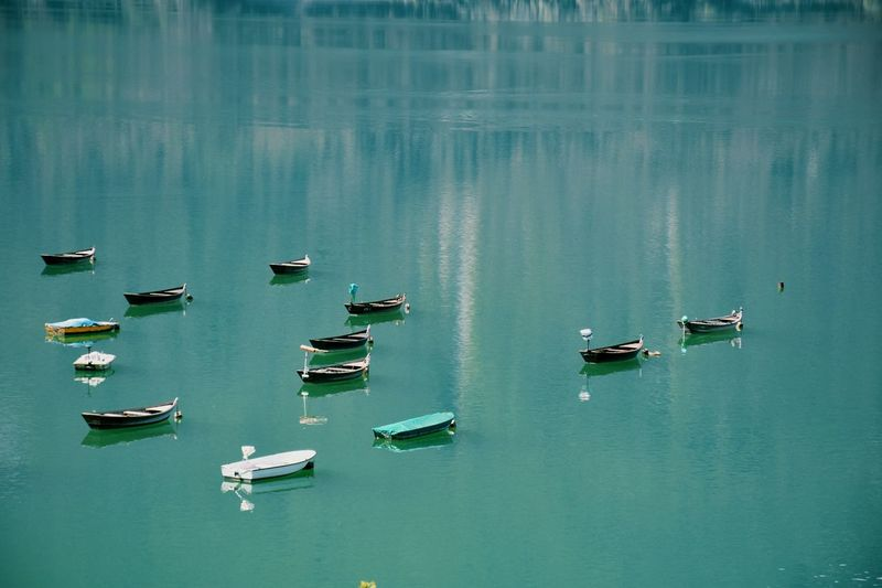 Moored Boats In Calm Lake