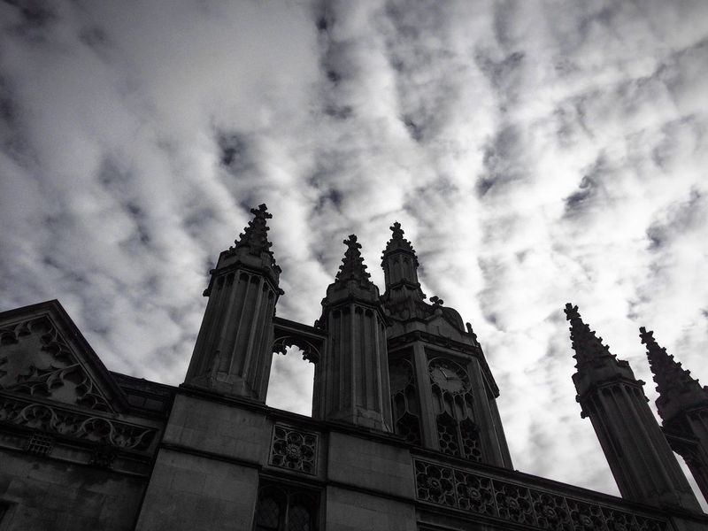 Higher Education EyeEm Selects Low Angle View Architecture Sky Cloud - Sky Built Structure Religion Building Exterior Spirituality Travel Destinations Sculpture Outdoors History Day No People Statue Place Of Worship