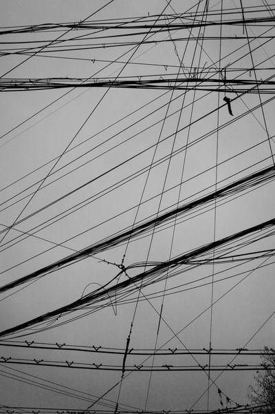 Low Angle View Cable No People Architecture Built Structure Electricity  Power Line  Sky Connection Power Supply Building Exterior Technology Full Frame Complexity Nature Fuel And Power Generation Day Outdoors City Building Modern Streetphotography Blackandwhite