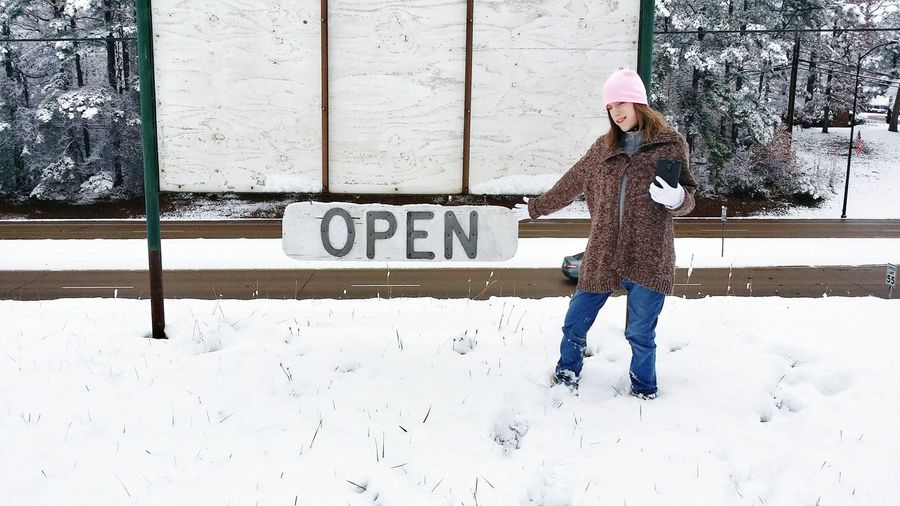 Town Street Open Sign Hillside Snow Girl Teen Cellphone Welcome Road Business Signage EyeEm Selects One Person Day Young Adult Outdoors One Young Woman Only Warm Clothing Cold Temperature Winter Standing Business Finance And Industry City