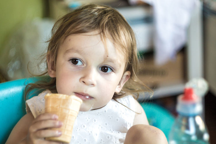 Baby Child Childhood Cute Dairy Product Day Eating Food Food And Drink Front View Headshot Holding Ice Cream Innocence One Person Portrait Real People Sweet Food