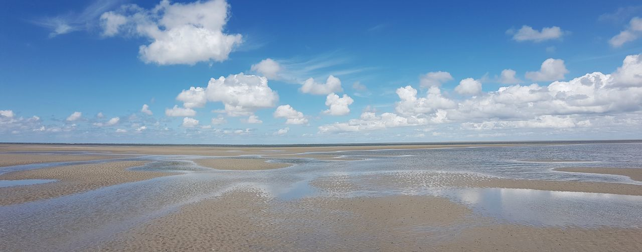 Nationalpark Schleswig-Holsteinisches Wattenmeer / National Park Wadden Sea in Schleswig-Holstein (May 28, 2019) Unesco World Heritage Panoramic Photography Panorama Tide Pools Waterscape Beach View Northsea North Sea Scenics - Nature Scenic Landscapes Wadden Sea Scenery Schleswig-Holstein Reflections In The Water Ebbe Und Flut Cloudy Skies National Park Wadden Sea National Park Tranquil Scene Low Tide Beach Beauty Sand Tide Coast Coastline Coastal Feature Seascape The Mobile Photographer - 2019 EyeEm Awards The Great Outdoors - 2019 EyeEm Awards