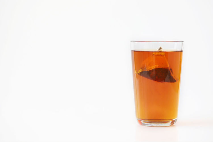 A glass of tea isolated on white background Drink Refreshment Glass Drinking Glass Food And Drink Studio Shot White Background Household Equipment Copy Space Indoors  Cut Out No People Single Object Alcohol Glass - Material Tea Close-up Cold Temperature Tea - Hot Drink Clean Crockery Tea Bag Tea