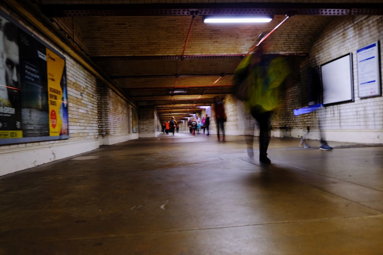 PEOPLE WALKING ON SUBWAY STATION