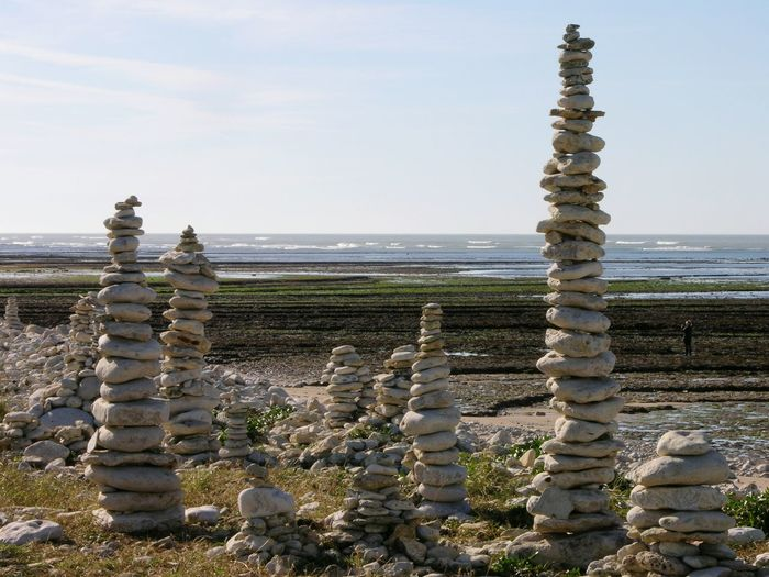 Pillar Stonehenge Seaside Ile D'Oleron Saint-denis D'Oléron France Nature Horizon Over Water Sky Sea Tranquility Sculpture Tranquil Scene Art And Craft Rock-object Art Clear Sky Stone-object Creativity Scenics Religion In A Row