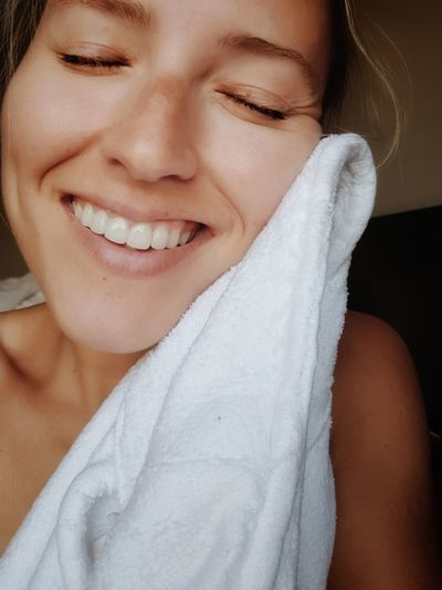 Close-Up Of Shirtless Woman Smiling With Towel
