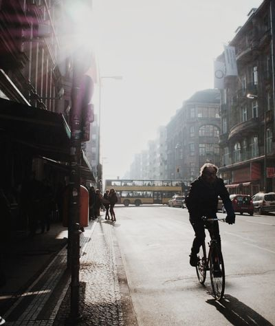 City Vertical Bicycle Cycling Built Structure Person People Adult Building Exterior Men Outdoors One Person Architecture Only Men Day One Man Only CyclingUnites Light And Shadow Architecture Bus Youth Group Youth Capture Berlin Streetscene Embrace Urban Life Welcome To Black