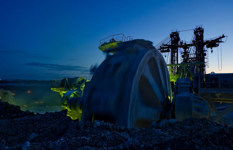 Bucket-wheel Excavator At Open-pit Mine Against Sky At Dusk
