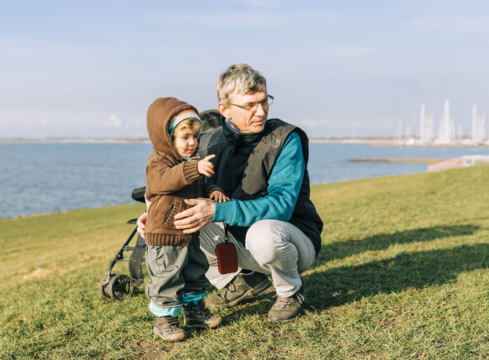 Toddler girl with grandfather on dyke of IJsselmeer – Hindeloopen, Netherlands, Europe Ijsselmeer Adult Baby Babyhood Beach Care Casual Caucasian Child Childhood Close-up Connection Crouching Dyke  Family Friesland Full Length Girl Grandchild Granddaughter Grandfather Grandparent Grass Hand Happy Hindeloopen Holding Horizon Kid Lake Love Man Mature Nature Netherlands Outdoors People Playing Pointing Portrait Sea Shadow Shore Standing Sunny Sunset Toddler  Togetherness Vacations Water Two People Bonding Males  Emotion Real People Positive Emotion Boys Sky Men Leisure Activity Mature Men