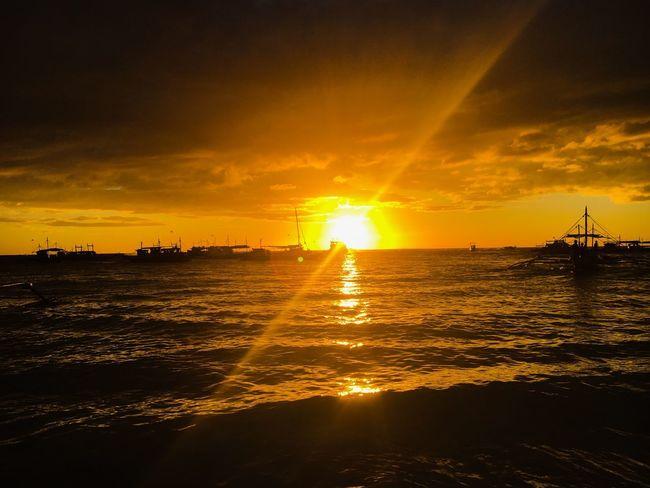 Fading light. Boracay's sunset. Sunset Mood Sunset Sun Sky Orange Color Sea Sunbeam Water Silhouette Reflection Sunlight Nautical Vessel Scenics