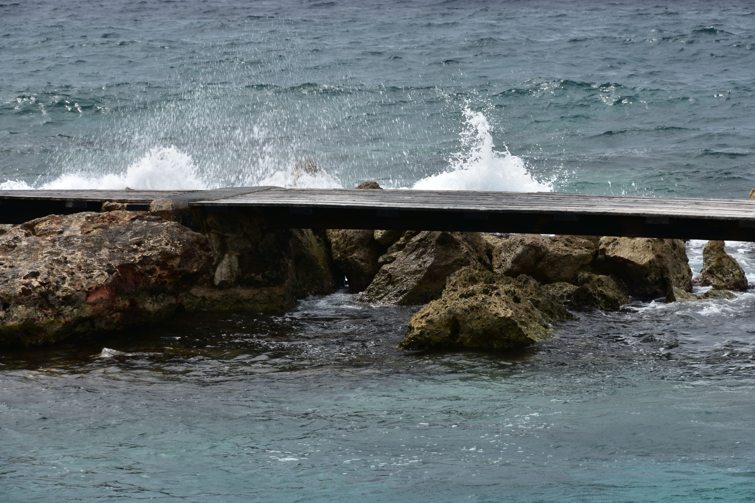 water, sea, surf, wave, splashing, motion, nature, rock - object, flowing water, rippled, waterfront, beauty in nature, day, power in nature, wet, outdoors, no people, shore, scenics, railing