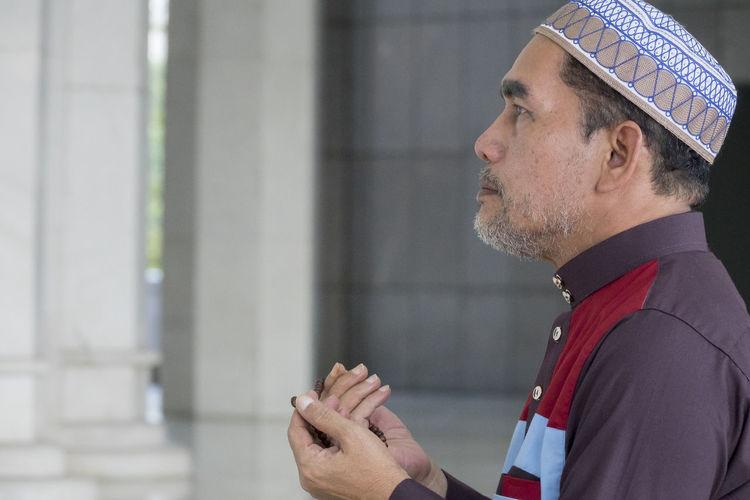 Middle age muslim man praying at mosque. Alone Man Mecca Saudi Arabia Allah Deeds Mosque Muslim Praying Reading Quran