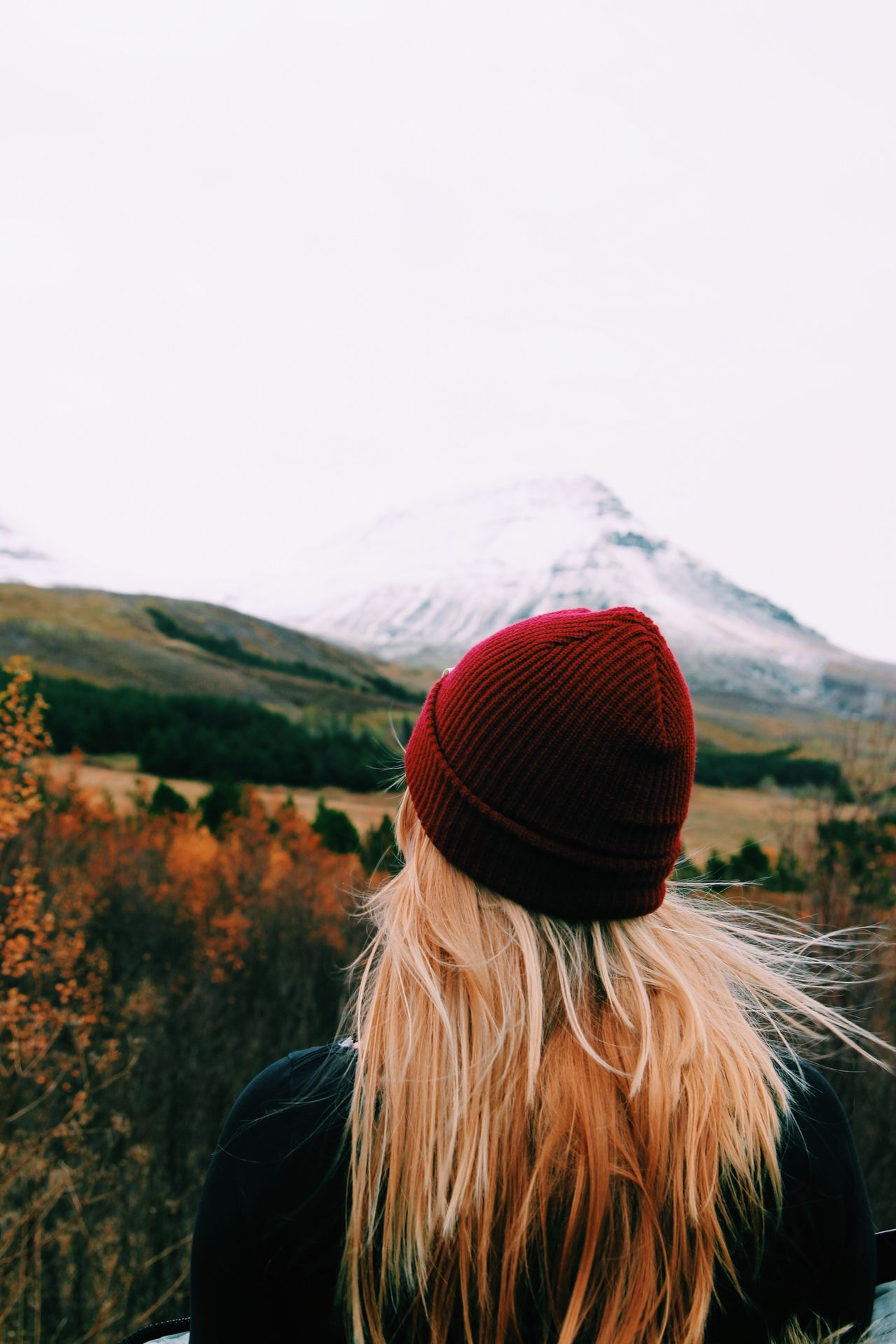 Rear view of woman wearing knit hat against clear sky