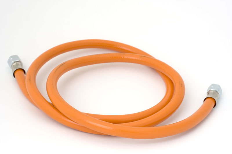 used gas hose on white with a soft shadow - camping gear Butane Camping Close-up Connection Equipment Fossil Fuel Fuel And Power Generation Full Length Gas Gas Hose Gaz Gear Hose Isolated Isolated On White LINE No People Orange Color Pressure Propane Single Object Studio Shot Tube Used White Background