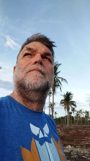 A man patiently waiting for the sun to vanish it's brightness. The Portraitist - 2019 EyeEm Awards Portrait Photography Portrait Of A Man  American Facial Expression Faces Of EyeEm Face Of A Man Beard Hairy  Hairy Guy Naturelovers Portrait Sportsman Headshot Looking At Camera Sky Close-up Cloud - Sky