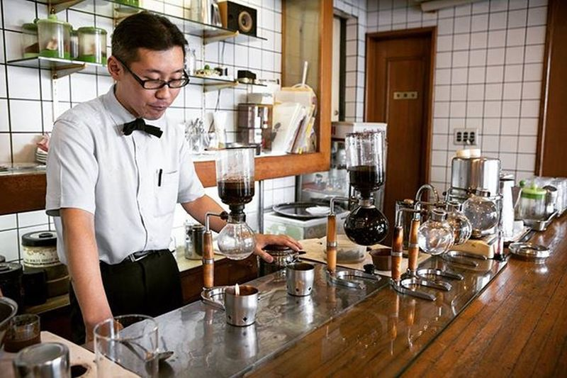 Hanafusa Coffee. Kyoto, Japan. This man made me one of the finest cups of coffee I've ever had in my life. Not pictured was the older man in the corner, the only customer at that moment. He sat quietly in his weathered leather jacket, hair slicked back, smoking a cigarette, and reading his newspaper quite contently. I took my time, savored my coffee, and felt grateful to have silently shared in that small moment. Shot with Canon 6D | Edited in Lightroom . Kyoto Japan @instagramjapan Coffee Hanafusacoffee Hanafusa Wanderlust Travelgram Travelandleisure Tlpicks Lpfanphoto Theadventurehandbook Adventure Trailblazer Outbounderlife Onephotoaday VSCO Vscogood Vscogrid Vscophile Vscocam TheRogersTravel Ultimate Japan