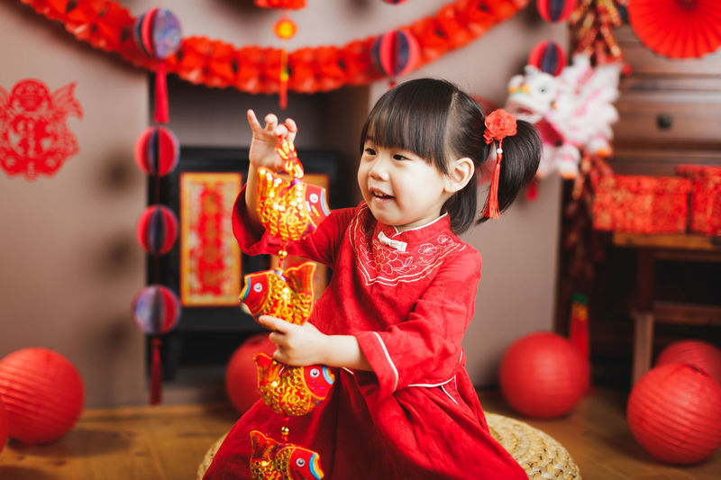 Cute girl standing in traditional clothing