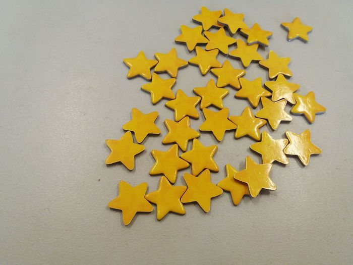 High Angle View Of Yellow Star Shaped Decoration On Table