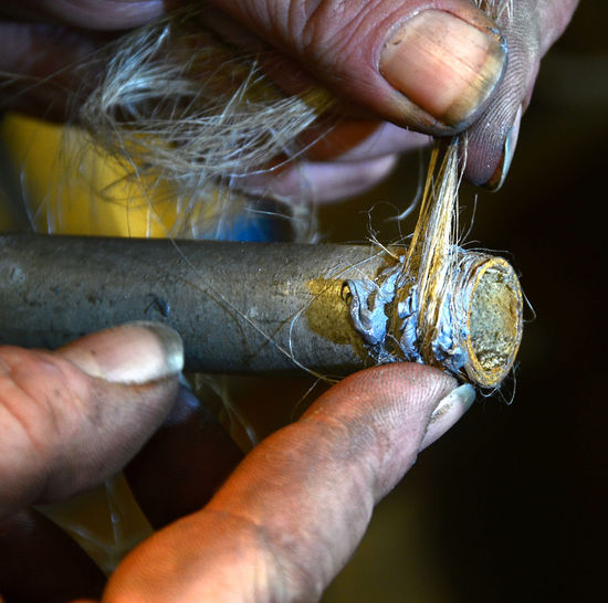 Cropped Image Of Worker Working On Tool