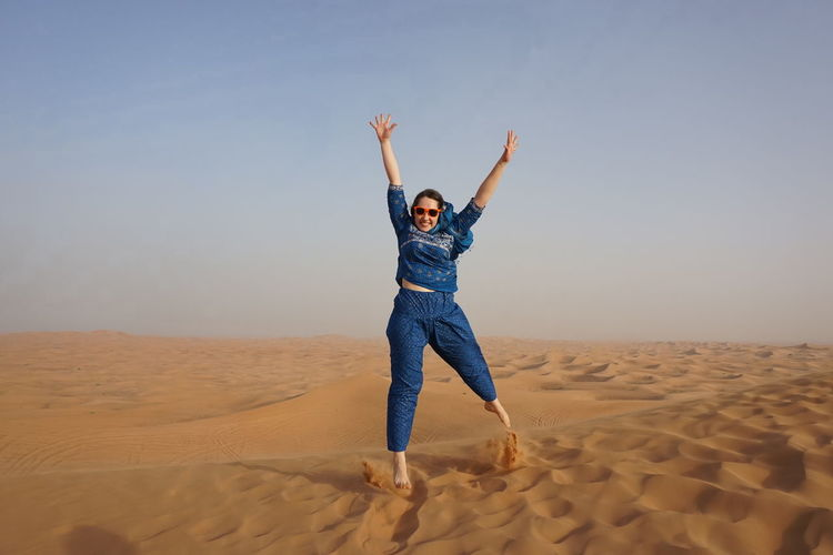 Dubai Safari Cute Holiday Trip Sky Amazing Nice Day♥ Happy Happiness Relaxing Ok Super World Nice Interesting Arms Raised Sand Only Women Desert One Woman Only Adult One Person Adults Only People Freedom Day Blue Young Adult Human Body Part One Young Woman Only