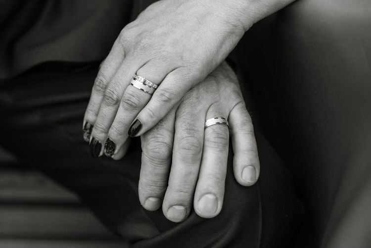Close-Up Of Couple Stacking Hands