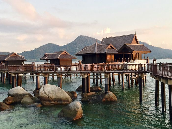Luxury on stilts EyeEm Selects Water Architecture Built Structure Building Exterior Sky Building Waterfront Stilt House Sea Wood - Material Outdoors