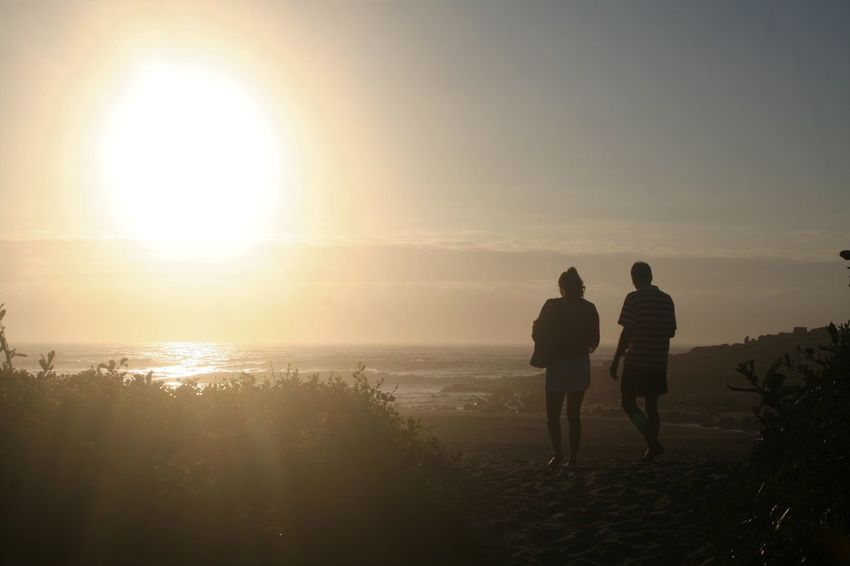 Full Length Horizon Over Water KwaZulu-Natal Coast Leisure Activity Nature Outdoors Real People Rear View Scenics Sea Silhouette Sun Sunlight Sunset Togetherness Tranquil Scene Two People Walking Water