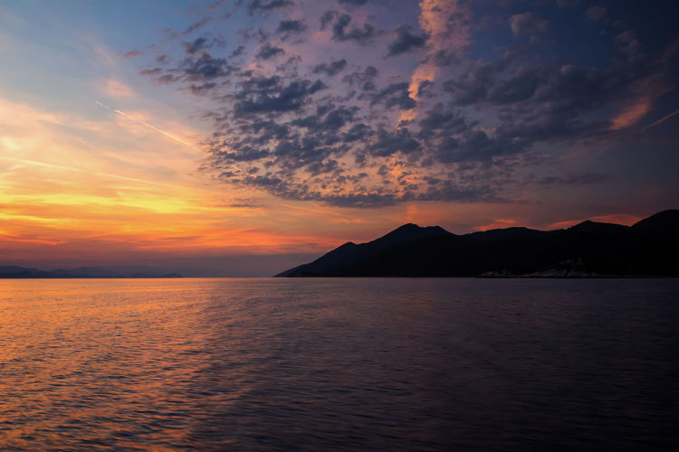 Cloudscape Sunset Silhouettes Travel Photography Beauty In Nature Cloud - Sky Clouds And Sky Horizon Horizon Over Water Idyllic Mountain Nature No People Non-urban Scene Orange Color Outdoors Scenics - Nature Sea Silhouette Sky Sunset Tranquil Scene Tranquility Water Waterfront Zen
