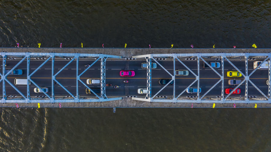 High angle view of cars on bridge over river