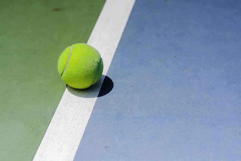 High angle view of yellow ball on table