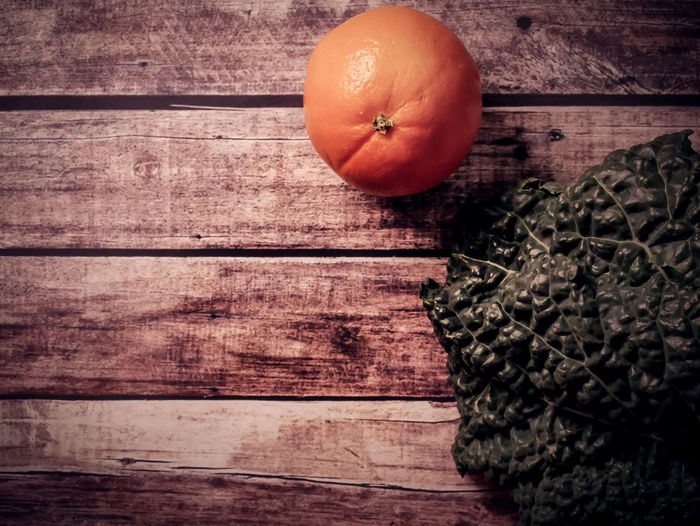 Wood - Material Food And Drink Food Healthy Eating Table Wellbeing Still Life Freshness Indoors  Fruit Vegetable No People Close-up Directly Above High Angle View Orange Color Wood Pumpkin Raw Food Single Object Ripe