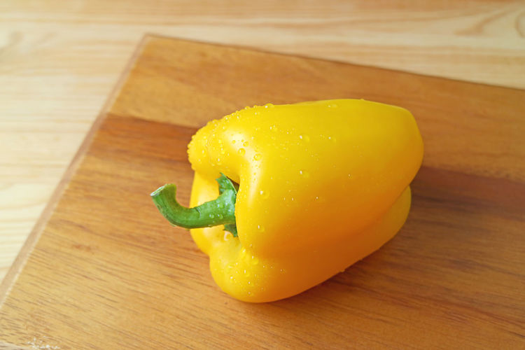 High angle view of yellow bell pepper on table