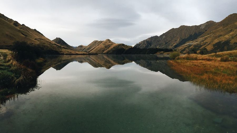 Reflection Water Mountain Sky Beauty In Nature Lake Nature Scenics Mountain Range Tranquility Outdoors Day Tranquil Scene Waterfront No People Water Reflections New Zealand Mirror Lake Symmetry Moke Lake Calm Calm Water Morning Morning Light Landscape