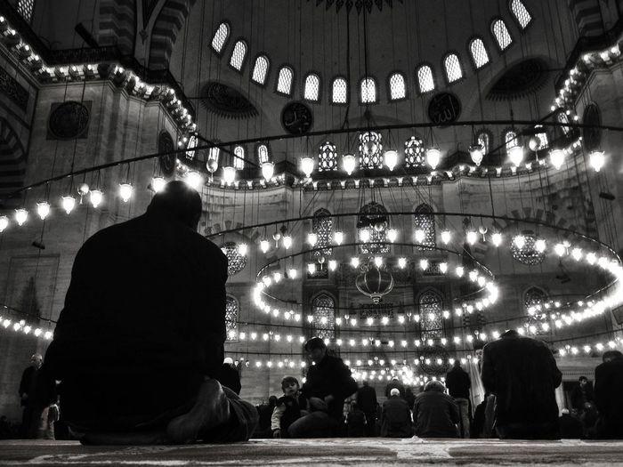 People visiting illuminated suleymaniye mosque