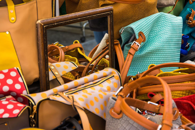 High Angle View Of Handbags By Mirror For Sale At Market Stall