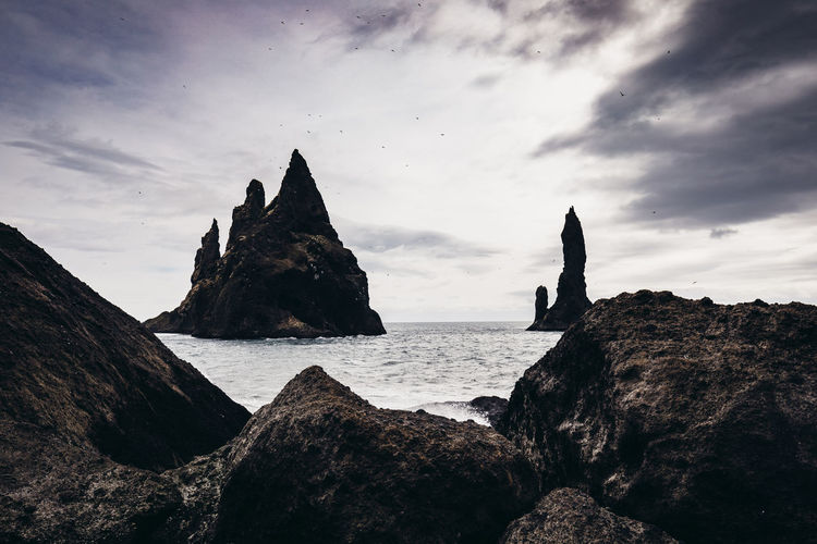 Rock Sky Sea Rock - Object Solid Water Cloud - Sky Scenics - Nature Beauty In Nature Rock Formation Tranquil Scene Nature Tranquility Beach No People Land Outdoors Horizon Stack Rock Vik Iceland Vík í Mýrdal Iceland Ominous Dark