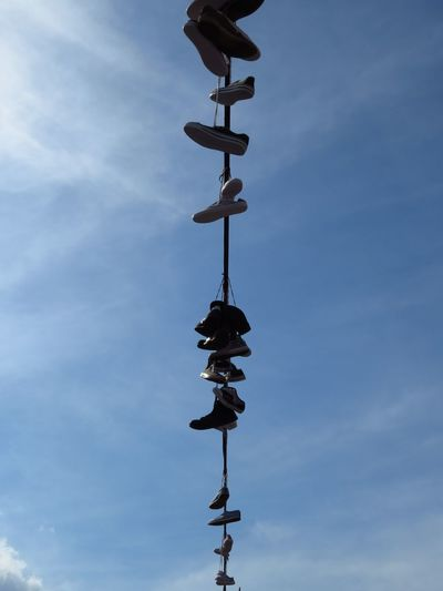 Hanging Lines Shoelover Shoes On A Wire Straight Line Cloud - Sky Direction Guidance Hanging Shoes Leave A Trace Leaving Something Behind Low Angle View On A Wire Outdoors Remnants Shoelaces Shoes Sky Weather Vane Wire