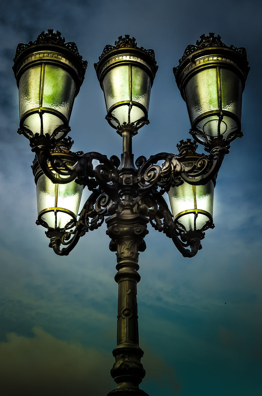 lighting equipment, street light, low angle view, sky, street, illuminated, nature, no people, antique, dusk, outdoors, cloud - sky, metal, retro styled, electric light, day, electricity, design, light, electric lamp, ornate