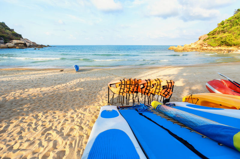 Blue kayaks and orange safety jackets on the tropical beach, Thailand Beach Beauty In Nature Day Horizon Over Water Kayak, Nature Nautical Vessel No People Outdoors Sand Scenics Sea Sky Sunlight Tranquil Scene Tranquility Water