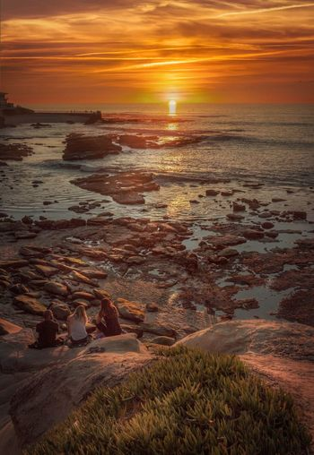 Friends make the world beautiful... La Jolla Cove San Diego Sunset Beauty In Nature Nature Sea Orange Color Scenics Beach Dramatic Sky Tranquility Water No People Outdoors Horizon Over Water Wave Tranquil Scene Landscape Sky Sun Travel Destinations Cloud - Sky