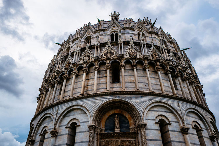 Low angle view of pisa cathedral against cloudy sky