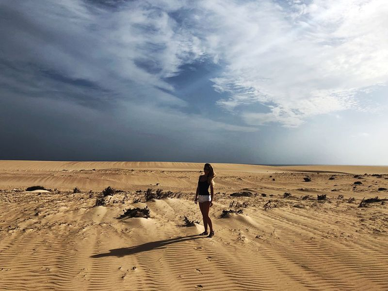 Sand Sky Desert Sand Dune Nature Cloud - Sky One Person Landscape Full Length Scenics Sunlight Arid Climate Beauty In Nature Walking Outdoors Tranquility Day Beach Real People