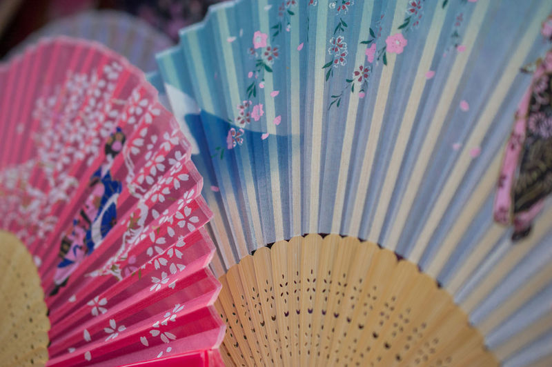 Selective focus close-up of Japanese hand fans Japan Japanese  China Chinese Close-up Fan Floral Pattern Focus On Foreground Foldable Hand Fan In A Row No People Pattern Selective Focus