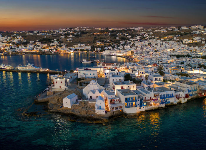 View to the town of Mykonos island just after a summer sunset, Cyclades, Greece Aegean Lights Mediterranean  Travel Architecture Building City Cityscape Cyclades Greece High Angle View Illuminated Island Mykonos Nature Sea Sky Summer Sunset Tourism TOWNSCAPE Travel Travel Destinations Water Waterfront