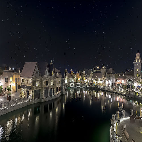 Dubai Dubai Parks Architecture Astronomy Building Building Exterior Built Structure City French Village Illuminated Nature Night No People Outdoors Place Of Worship Reflection River Sky Space Space And Astronomy Star Star - Space Water Waterfront
