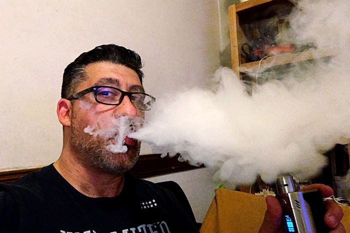 Vaping time Electronic Cigarette Vapor Vaping Is The Future Vaporfanatics VapeLife Vapecommunity Portrait One Person Young Adult Headshot Real People Lifestyles Young Men Glasses Indoors  Looking At Camera Leisure Activity Front View Home Interior Eyeglasses  Smoke - Physical Structure Adult Casual Clothing