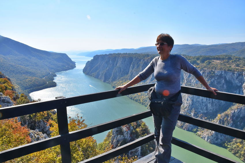 Danube gorge, Serbia One Person Railing Mountain Leisure Activity Real People Standing Lifestyles Front View Nature Day Casual Clothing Sky Scenics - Nature Beauty In Nature Portrait Mountain Range Outdoors Water River Woman Mature Adult Fence Wooden Autumn Hiking